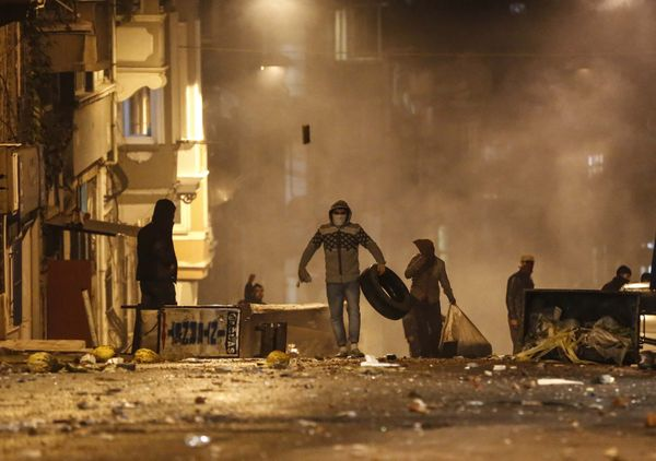 Protestors make barricades against Turkish police during unauthorized demonstrations against the advance of Islamic State of