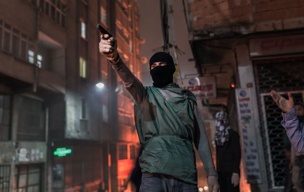 An armed protester on the streets of Istanbul.