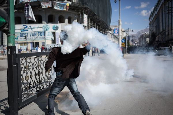 Protesters clash with police during demonstrations against lack of action by the government towards Islamic State insurgents