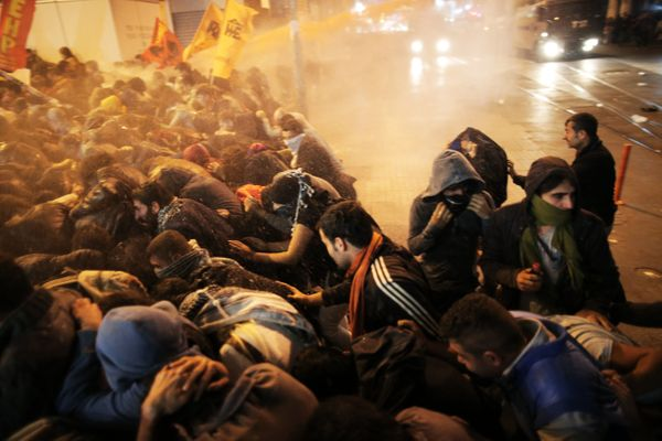 Police use water cannon and tear gas against protestors.