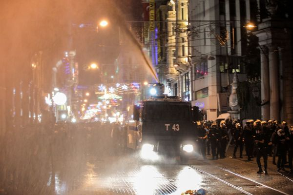 Turkish riot police use tear gas and water cannons to disperse protesters.