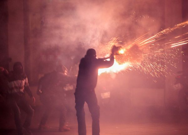 Turkish riot police use tear gas to disperse people who were protesting against Turkey's policy in Syria.