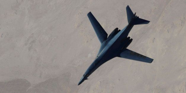 In this Saturday, Sept. 27, 2014 photo released by the U.S. Air Force, a B-1B Lancer disengages from a KC-135 Stratotanker af