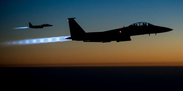 In this Tuesday, Sept. 23, 2014, photo, released by the U.S. Air Force, a pair of U.S. F-15E Strike Eagle flies over northern