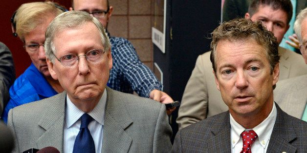 Kentucky Sens. Mitch McConnell, left, and Rand Paul speak with reporters following their appearance at the 50th annual Kentuc