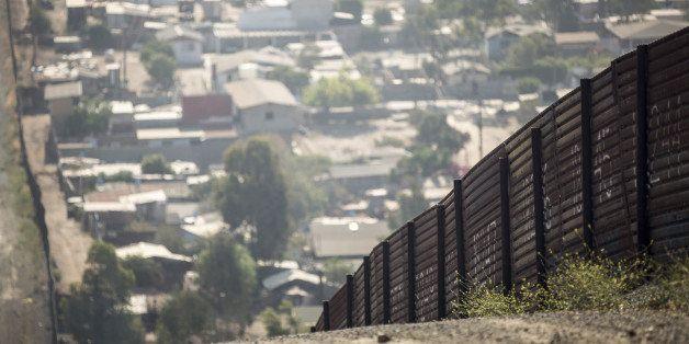 SAN DIEGO, CA - MAY 27:  The U.S.-Mexico border fence overlooking Tijuana, Mexico on May 27, 2014 near San Diego, California.
