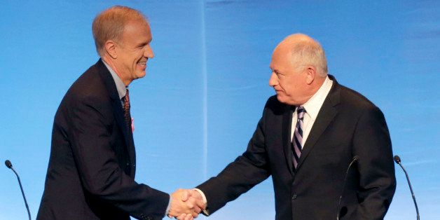 Illinois gubernatorial candidates Republican Bruce Rauner, left, and Democrat Gov. Pat Quinn greet before a debate at the DuS