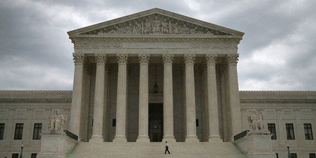 WASHINGTON, DC - AUGUST 20:  Guards stand in front of the Supreme Court Building, August 20, 2014 in Washington, DC. Today th