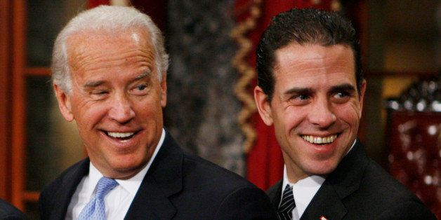 Vice President-elect, Sen. Joe Biden, D-Del., left, stands with his son Hunter during a re-enactment of the Senate oath cerem