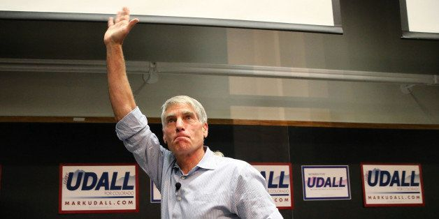 U.S. Sen. Mark Udall, D-Colo., waves to a crowd during a rally attended by U.S. Sen. Elizabeth Warren, D-Mass., to push for t