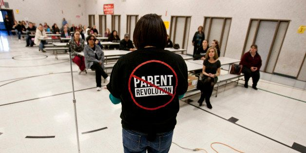 Desert Trails Elementary parents Chrissy Alvarado, right, address a group of parents against the takeover of the school by th