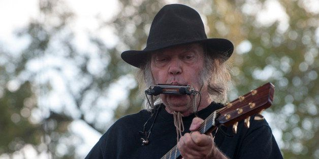 Neil Young performs at the Harvest the Hope concert in Neligh, Neb. on Saturday, Sept. 27, 2014. The concert in northeast Neb