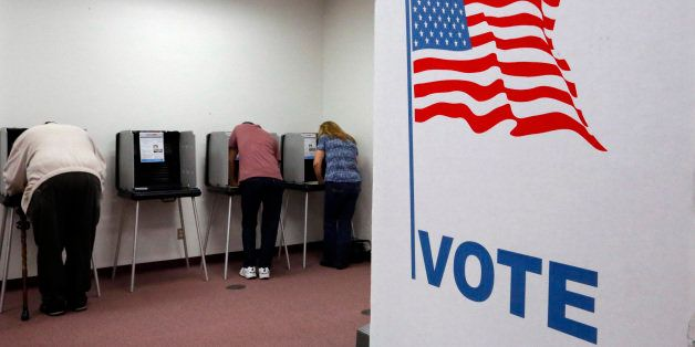 Registered voters cast ballots during the early voting period at the Sangamon County Building Monday, Oct. 20, 2014, in Sprin