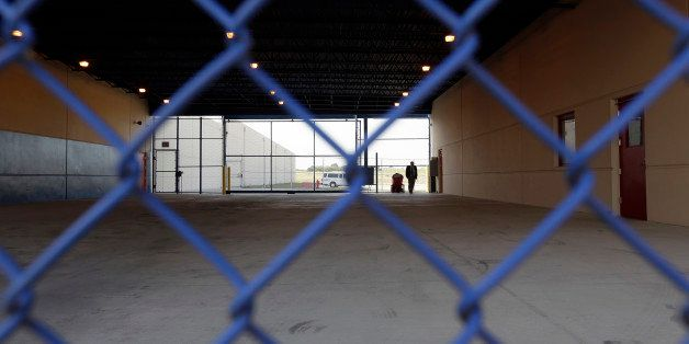 A secured entryway is seen at the Karnes County Residential Center in Karnes City, Texas on Thursday, July 31, 2014. Federal