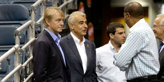 MILWAUKEE, WI - JULY 2: (L-R) Owners Wesley Edens (L) & Marc Lasry (2L) await for the official announcement of their new head