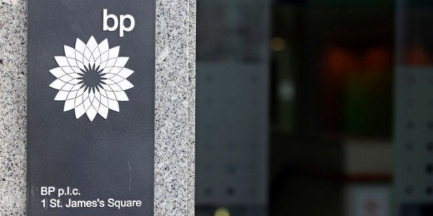 The BP Plc company logo sits on a sign outside the company's headquarters in St. James's Square in London, U.K., on Thursday,