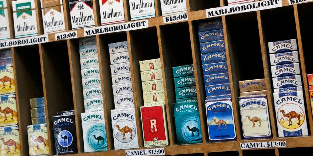 In this March 18, 2013 file photo cigarette packs are displayed for sale at a convenience store in New York. No one under 21