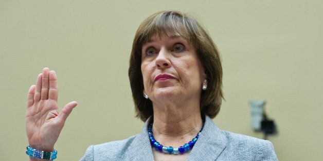 Internal Revenue Service Director of Exempt Organizations Lois Lerner(C) is sworn in before testifying to the House Oversight