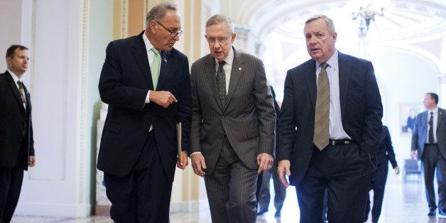 UNITED STATES - SEPTEMBER 11: From left, Sen. Charles Schumer, D-N.Y., Senate Majority Leader Harry Reid, D-Nev., and Senate