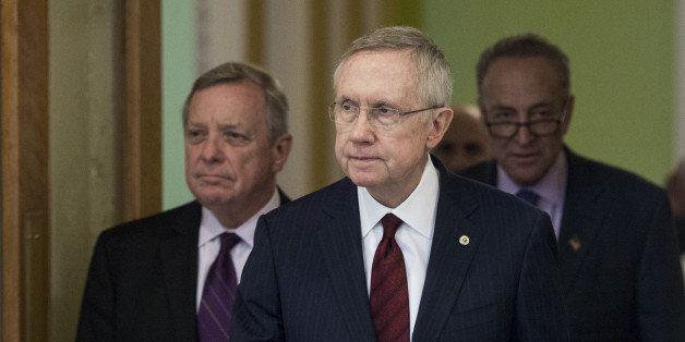 UNITED STATES - SEPTEMBER 18: Senate Majority Leader Harry Reid, D-Nev., followed by Senate Assistant Majority Leader Dick Du