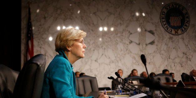 Sen. Elizabeth Warren, D-Mass., waits to questionTreasury Secretary Jacob Lew as he testifies before the Senate Banking, Hous