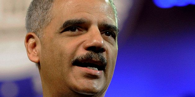 FILE - In this July 10, 2012 file photo, Attorney General Eric Holder speaks in Houston. Holder is cutting short an overseas