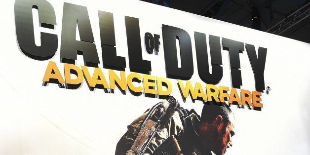 Visitors of the 'Gamescom' fair play the 'Call of duty' game on August 14, 2014 during the Gamescom fair in Cologne, western