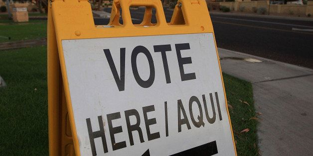 PHOENIX - NOVEMBER 4:  A bilingual sign announces a polling place in the home state of Republican presidential nominee U.S. S