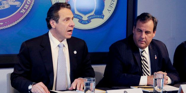 New York Governor Andrew Cuomo, left, speaks as New Jersey Governor Chris Christie listens at a news conference, Friday, Oct.