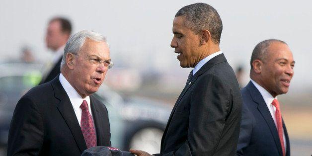 BOSTON - OCTOBER 30: U.S. President Barack Obama received a Boston Red Sox hat from Boston Mayor Thomas Menino while Governor