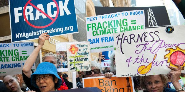NEW YORK, NY - SEPTEMBER 23:  Anti-fracking demonstrators protest on 51st Street and 7th Avenue as President Obama arrives at