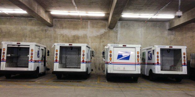 Santa Monica, Ca - October 20, 2014. Four parked U.S. Postal Service mail trucks.