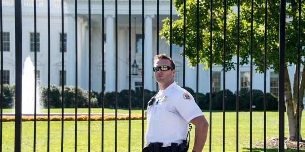 A member of the US Secret Service Uniformed Division patrols in front of the White House in Washington on October 25, 2014. F