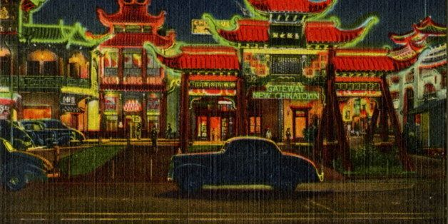 UNITED STATES - CIRCA 1943:  Postcard view of Chinatown at night showing the building lit by neon. Vintage automobiles are on
