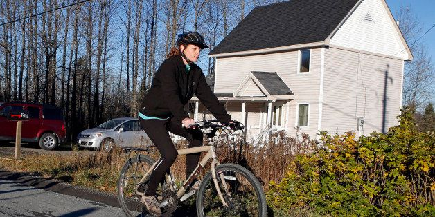 Nurse Kaci Hickox rides away from the home she is staying in on a rural road in Fort Kent, Maine, to take a bike ride, Thursd