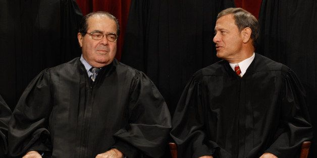 WASHINGTON - OCTOBER 08:  U.S. Supreme Court Associate Justice Antonin Scalia (L) and Chief Justice John Roberts talk while p