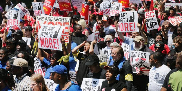 OAK BROOK, IL - MAY 21:  Fast food workers and activists demonstrate outside the McDonald's corporate campus on May 21, 2014