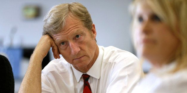 Businessman Tom Steyer listens during a meeting to announce the launch of a group called Virginians for Clean Government at V