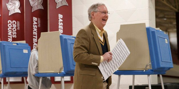 Senate Minority Leader Mitch McConnell, R-Ky., casts his ballot in the midterm election at the voting precinct at Bellarmine