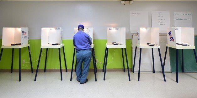 A voter casts his vote at a polling station in Pasadena, California, on November 4, 2014. Months of campaign promises, partis