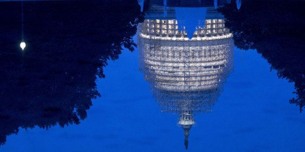 The U.S. Capitol Building is reflected in the Senate reflecting pool while undergoing repairs in Washington, D.C., U.S., on W