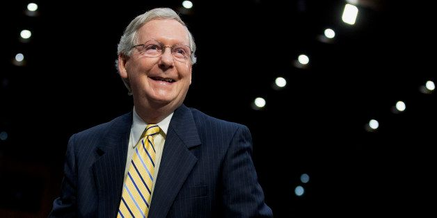 Senate Minority Leader Mitch McConnell of Ky.,smiles on Capitol Hill in Washington, Tuesday, June 3, 2014, following his test