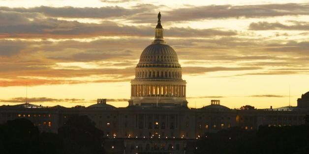 WASHINGTON, :  The sun rises over the United States Capitol on the Mall in Washington, DC 10 September 2002.  The US Capitol