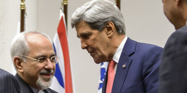 ALTERNATIVE CROP Iranian Foreign Minister Mohammad Javad Zarif (2nd L) shakes hands with US Secretary of State John Kerry as