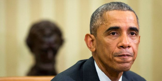 President Barack Obama pauses as he speaks to the media about the government's Ebola response in the Oval Office of the Whi