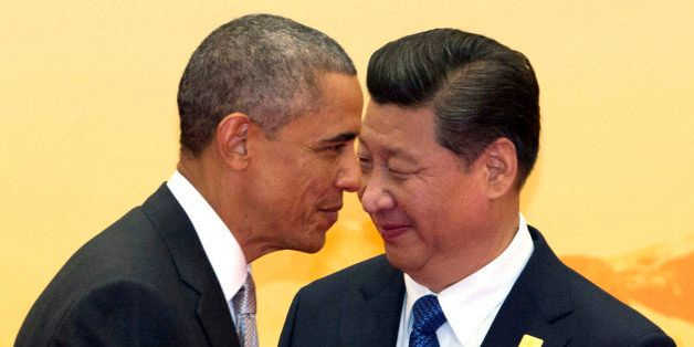 U.S. President Barack Obama, left, walks past Chinese President Xi Jinping during a welcome ceremony for the Asia-Pacific Eco