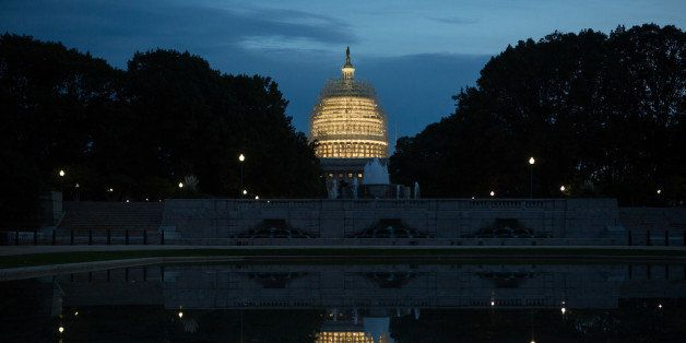 WASHINGTON, DC - NOVEMBER 4: Evening arrives at the Capitol building, covered in scaffolding for major repairs, on Capitol Hi