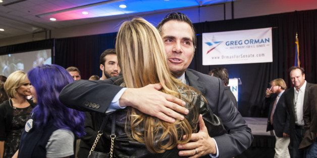 OVERLAND PARK, KS -  NOVEMBER 4:   Independent candidate, Greg Orman hugs supporters at a watch party on election night at th