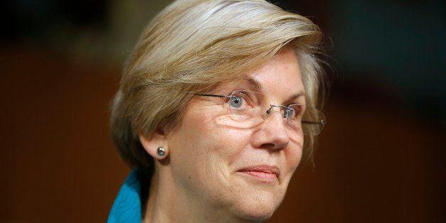 This photo taken June 25, 2014, shows Sen. Elizabeth Warren, D-Mass., questions Treasury Secretary Jacob Lew as he testifies