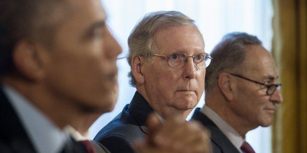 Senate Minority Leader Mitch McConnell, R-Kentucky (C), and US Senator Chuck Schumer(R), D-New York, look on as US President